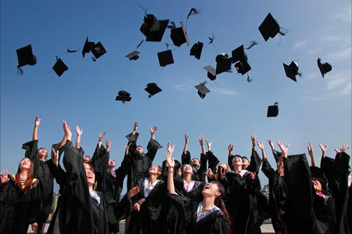 throwing graduation hats in the air